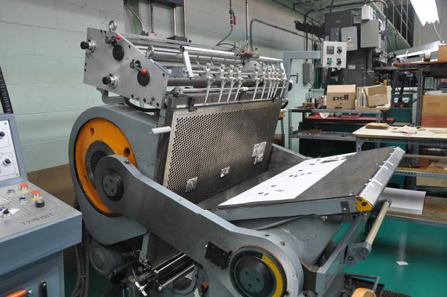 Matrices en magnésium en position sur la presse (Gravure Choquet)